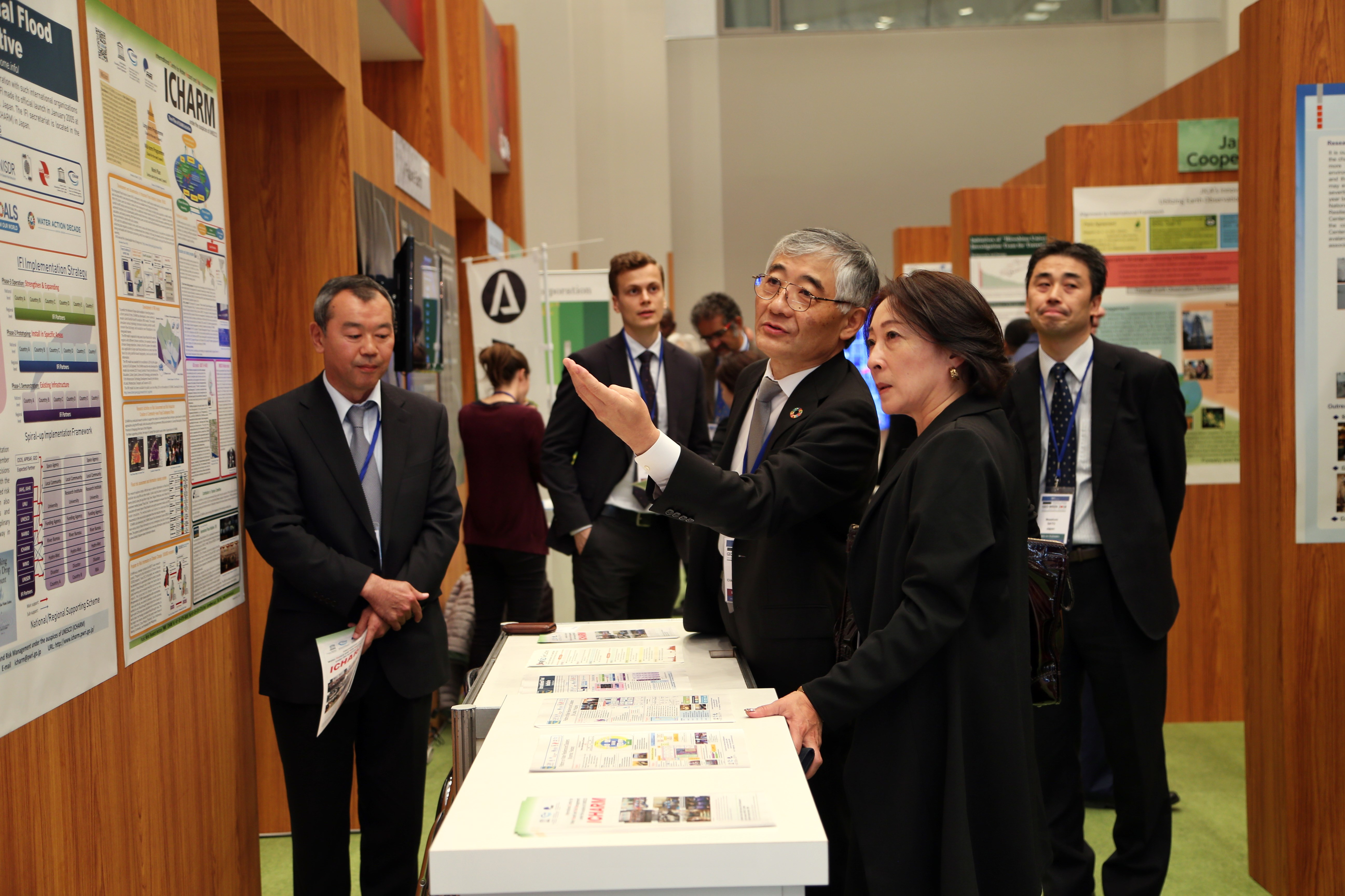 ICHARM Director Toshio Koike speaks with Mami Mizutori, Special Representative of the United Nations Secretary-General for Disaster Risk Reduction, at the GEO Week 2018 Exhibition.