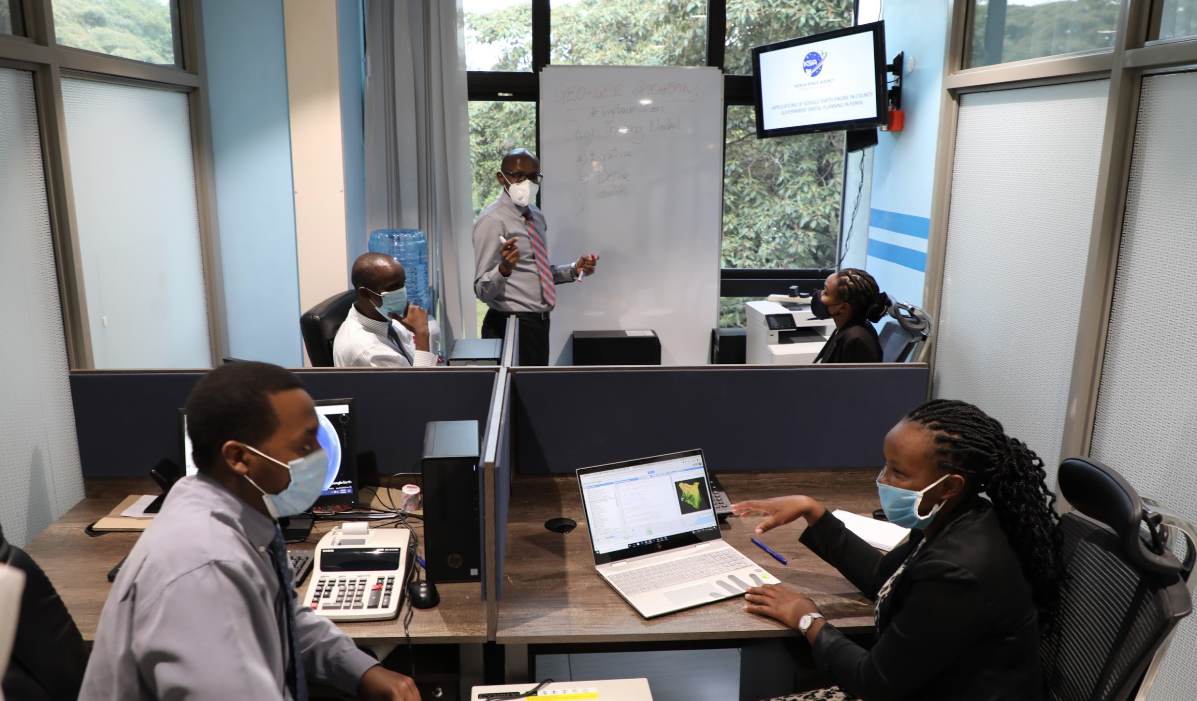 Kenya Space Agency Project team led by Mr. Charles Mwangi (standing) planning the implementation of the GEO-GEE unlimited license award.